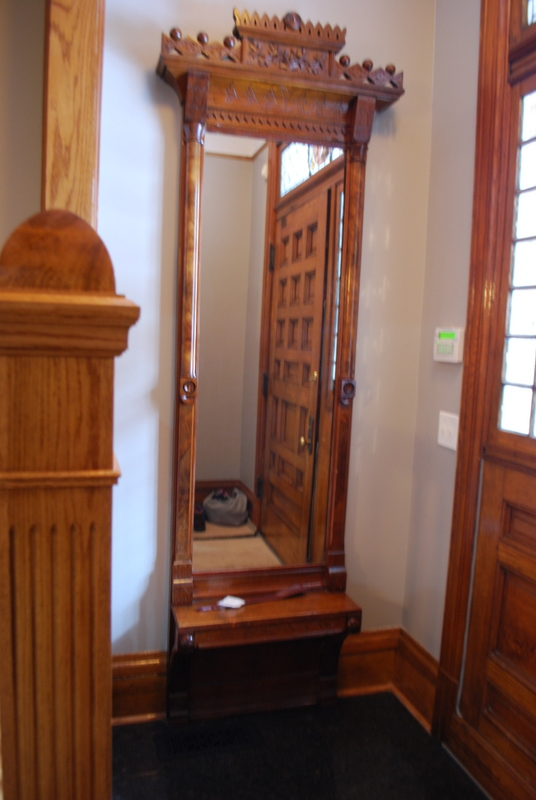 This hall mirror was relocated from elsewhere in the house.  The newel in the side of this photograph is a new one, made to match the existing newels.